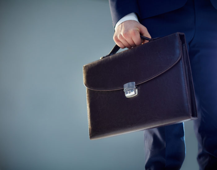 Isolated image of a businessman carrying a briefcase